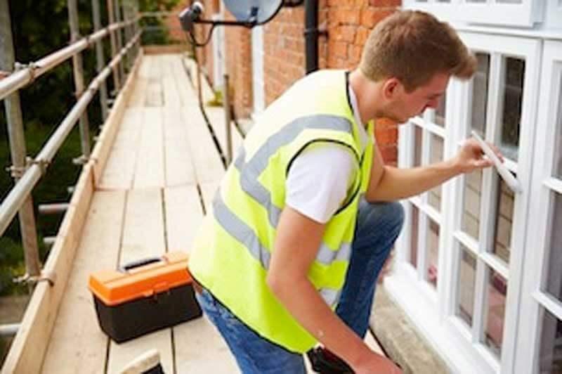 bigstock-decorator-on-scaffolding